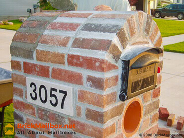 Close up of brick mailbox before clean up