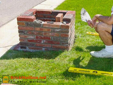Half way done building the brick mailbox