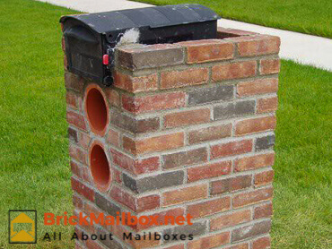 Left side of the brick mailbox
