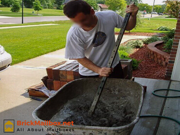 Mixing concrete for the brick mailbox
