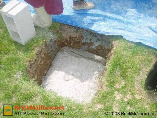Pour cement into hole and then smooth the pad until it is level. Let it cure for at least 24 hours.